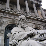 A close-up of the sculpture of San Isidoro in front of the Biblioteca Nacional de España in Madrid.