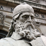An extreme close-up of the sculpture of San Isidoro in front of the Biblioteca Nacional de España in Madrid.