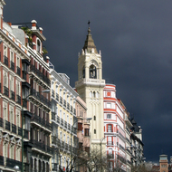 Buildings near the Puerta de Alcal� with storm clouds.