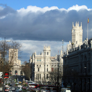 A downtown Madrid street scene, looking to the Palacio de Communicaciones and the Puerta de Alcal�.
