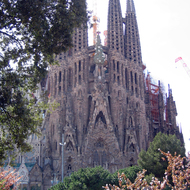 A view of La Sagrada Familia from across the street in a public park.