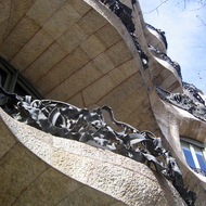 A close-up of the balconies of the Casa Mila from below.