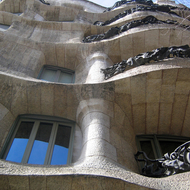A close-up of the Casa Mila from below.