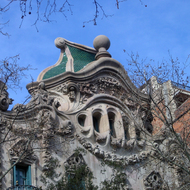 A close-up of the top of the Casa Comalat in Barcelona.