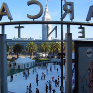 The ice skating rink at the Embarcadero, with the Ferry Building clock tower.