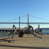 A sculpture next to the Ferry Building in San Francisco, with the Bay Bridge in the background.
