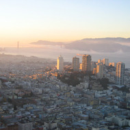 A view across San Francisco to the Golden Gate Bridge at dusk from the Bank of America building (the tallest building in San Francisco).