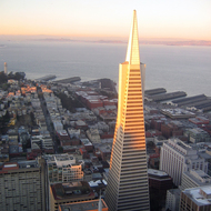 The Transamerica Pyramid from the top of the Bank of America building (the tallest building in San Francisco) at sunset.