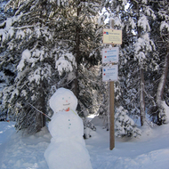 A snowman trailside at the Royal Gorge Cross-country Ski Resort in California.