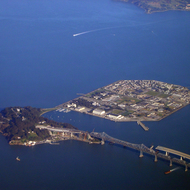 An aerial view of Treasure Island, the Bay Bridge (with the new span under construction), and Alcatraz (upper left corner).