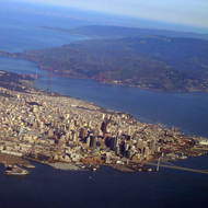 An aerial view of San Francisco, the Bay and Golden Gate Bridges, and the Marin Headlands.