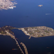 An aerial view of Treasure Island, the Bay Bridge (with the new span under construction), and part of San Francisco.