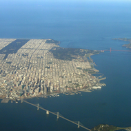 An aerial view of San Francisco, The Bay Bridge, and the Golden Gate.
