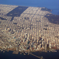 An aerial view of San Francisco, with Golden Gate Park in the upper left and the Presidio on the right.