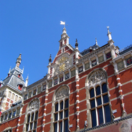 An exterior view of the main train station in Amsterdam.