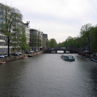 A canal boat and canal in Amsterdam.