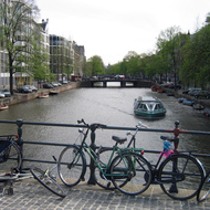 A canal boat, canal, and bikes in Amsterdam.