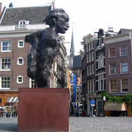 A monument to the famous Dutch writer Multatuli (a pseudonym of Eduard Douwes Dekker) on a bridge over a canal.