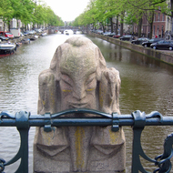 A bridge pillar over a canal in Amsterdam.