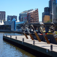 Dockside art along the Yarra River, with the Melbourne Aquarium in the background.