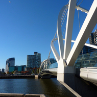 The Seafarers Bridge (for bikes and pedestrians) across the Yarra River in Melbourne, with a bird in flight.