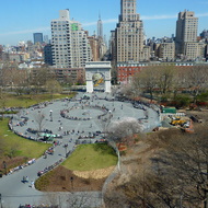 A view of Washington Square Park, with Washington Square Arch, as viewed from a New York University building and looking toward the Empire State Building in the distance.