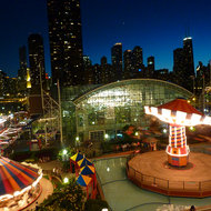 A view of the Navy Pier amusement rides and the Chicago skyline from the Ferris Wheel.