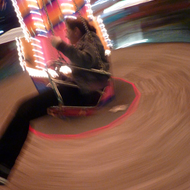A girl enjoying an amusement ride at Navy Pier in Chicago.