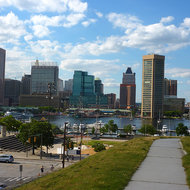 The Baltimore inner harbor as seen from a lower level of Federal Hill Park.