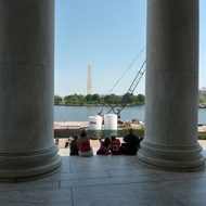 A view from the portico of the Jefferson Memorial looking out to the Washington Monument.