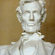 A close-up of the statue of Abraham Lincoln inside the Lincoln Memorial.