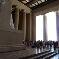 A crowd of visitors inside the Lincoln Memorial.