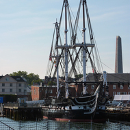 The USS Constitution docked near the Bunker Hill Monument in Boston Harbor.