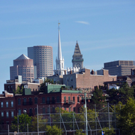 A view of the Old North Church in Boston, as well as other downtown Boston buildings, from the Charles River.
