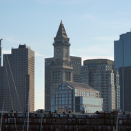 A view of downtown Boston, old and new buildings, from the Charles River.