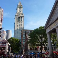 The Quincy Market in the foreground with Marriott's Custom House in Boston.
