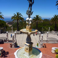 A fountain and the Pacific Ocean at Hearst's Castle.