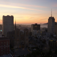 A view of San Francisco at Sunset from the Top of the Mark (Hopkins Hotel), with the Golden Gate Bridge in the background.