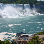The American Falls and the Maid of the Mist loading on the Canadian side of Niagara Falls.