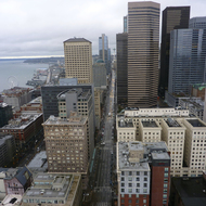 The Seattle Space Needle and surrounding city buildings from the top of the Smith Tower (of Smith-Corona typewriter fame).