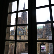 A view of the Cathedrale Notre-Dame de Strasbourg from inside the Palais Rohan in winter.
