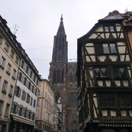 A view of the Cathedrale Notre-Dame de Strasbourg from a nearby Strasbourg street.