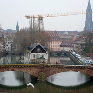 Old town Strasbourg with a construction crane and the Cathedrale Notre-Dame de Strasbourg.