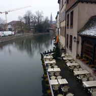 A cafe along a river in Strasbourg in winter.
