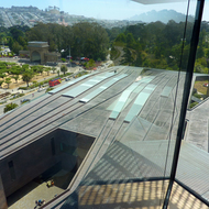 The roof of the de Young Museum and the bandstand at the Music Concourse of Golden Gate Park, as seen from the de Young Museum tower.