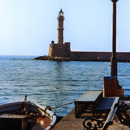 The lighthouse at the entrance to the Chania harbor, Crete.