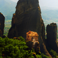The pinnacles of Meteora, with a monastery perched on one.
