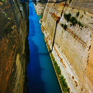 The Corinth Canal that bisects the Isthmus of Corinth between the Peloponnesian peninsula and the Greek mainland.