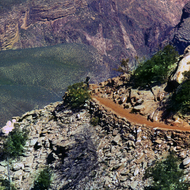 A backpacker turns a corner on the Kaibab Trail.