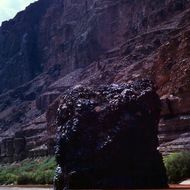 A volcanic plug, Vulcan's Anvil, just above Lava Falls on the Colorado River.